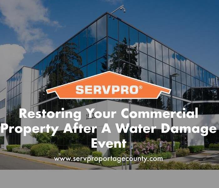 Orange SERVPRO house logo on image with business building in background.