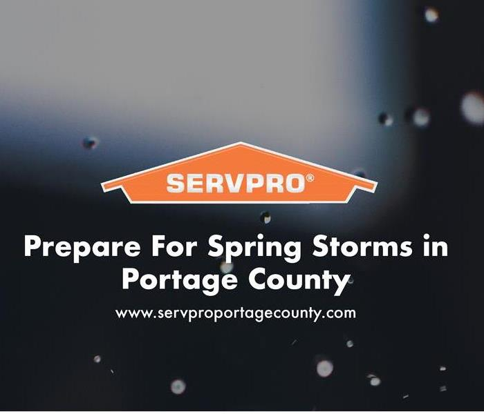 Orange SERVPRO house logo on image with rain drops