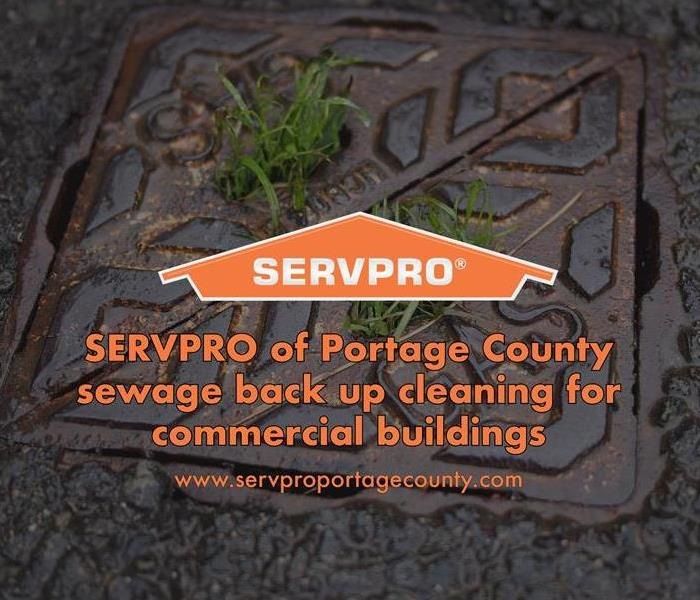 Orange SERVPRO  house logo on dark image with a sewer.