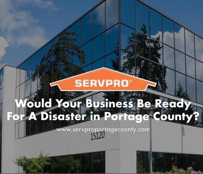 Orange SERVPRO  house logo on image with business building in background