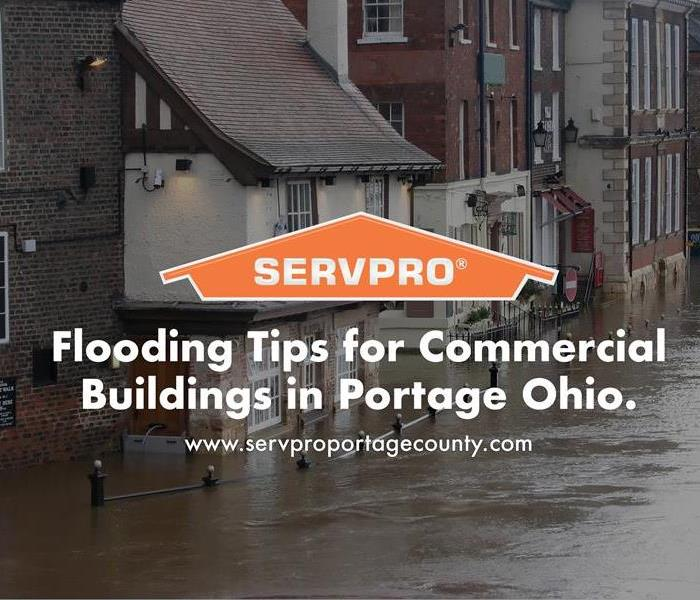 Orange SERVPRO  house logo on flooding and businesses.