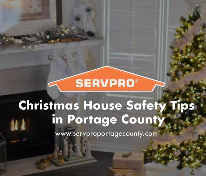 Orange SERVPRO  house logo on image with house and Christmas tree in background