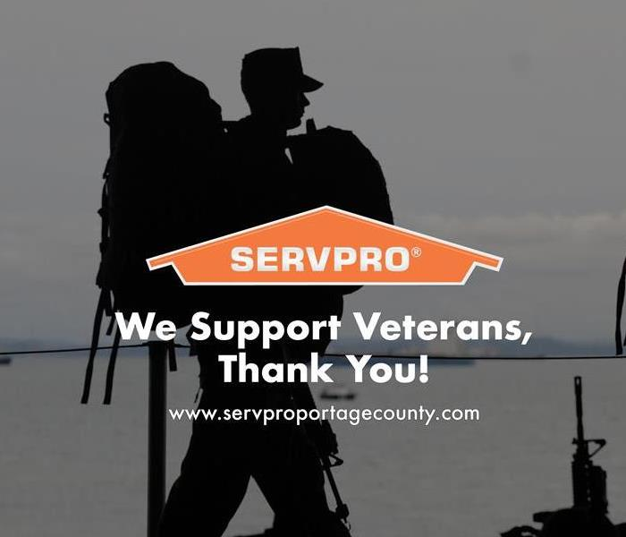 Orange SERVPRO  house logo on image with soldiers walking.