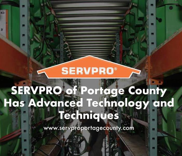 Orange SERVPRO house logo on image with SERVPRO equipment
